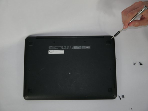 Flip the Chromebook onto its back, where there are eleven screws.