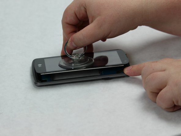 Once you have loosened the grip around the edges, pop off the screen using a suction cup.