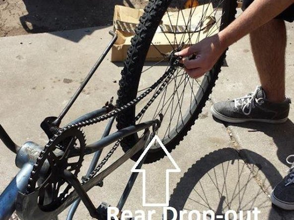 Slip the chain onto the crank and rear cog. Then insert wheel into rear drop-outs.