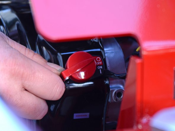 Flip the red engine ON/OFF switch to the ON position.