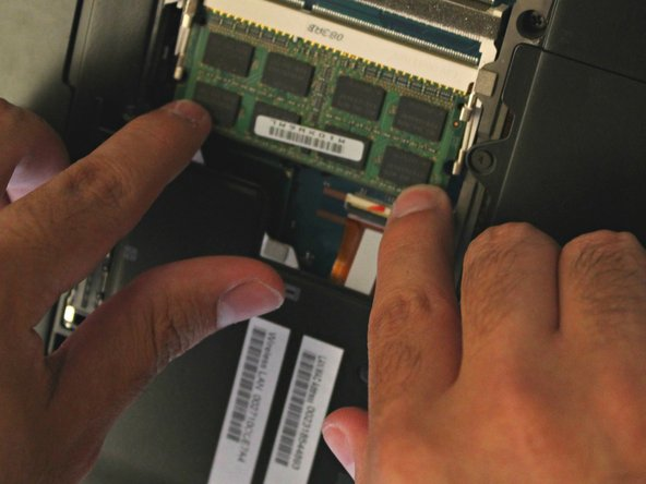 Place new RAM into the RAM drive and gently press until there is a slight pop.