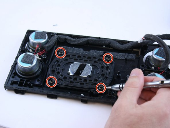 Remove the four screws from the subwoofer and lift it out of the casing.