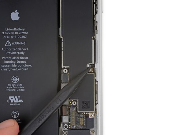 Use the point of a spudger to push the SIM card eject plunger out of the logic board's way.