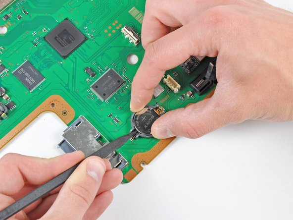 Image 1/1: Failure to hold the plastic retainer down during the prying process may result in it tearing off the motherboard.