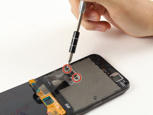 Using a screwdriver, remove the two black 3.5 mm T5 screws holding the bracket in place.
