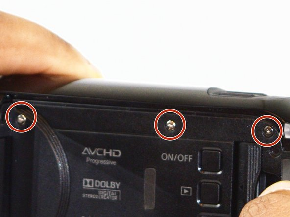Turn the camera over to the side with the LCD screen, and open the screen.