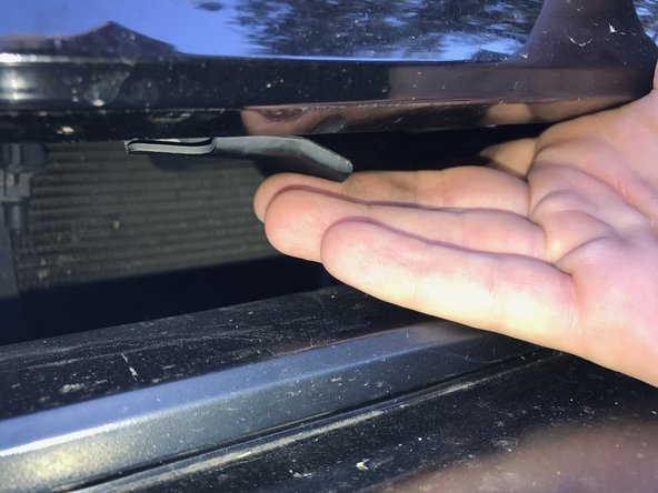 Image 3/3: Use one hand to lift up on the latch and your other hand to lift the hood open.