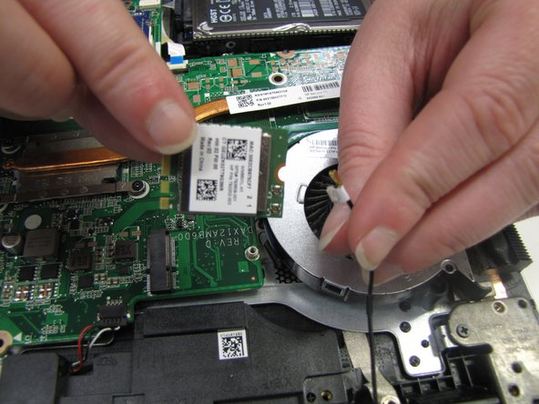 After unscrewing the screws, lift the Video Card up from the motherboard. Disconnect the wire from the Video Card by gently wiggling the gold end on the left corner of the card.