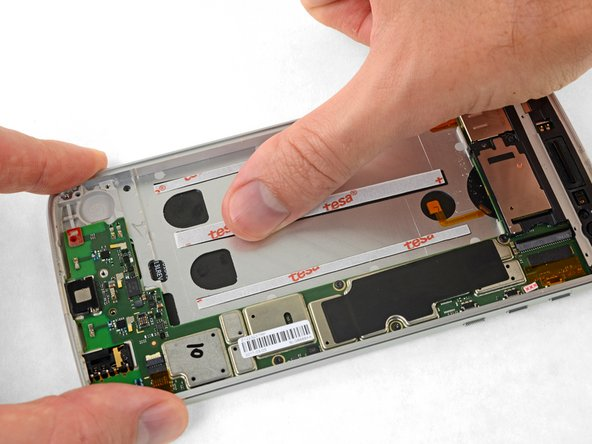 Before applying any adhesive, make sure your replacement part fits, and that all connectors will connect without putting too much stress on their cables. If it is safe to do so, power on your device and verify that everything functions correctly. If everything works, power off the device and continue.