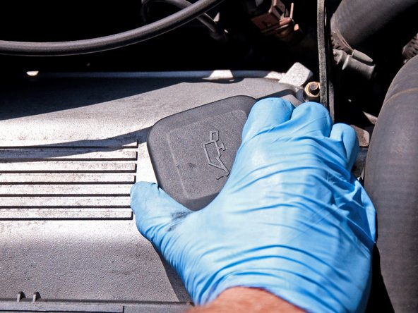 Twist the oil filler cap 1/4 turn counter-clockwise and remove it from the valve cover.