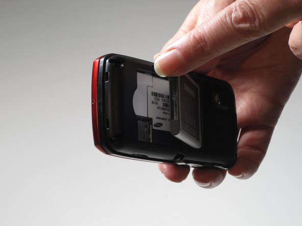 Place your thumb at the noched area at the bottom portion of the phone.