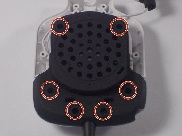 Remove the six 7 mm screws indicated in red using a PH00 screwdriver.
