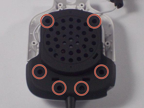 Image 1/2: Separate the black speaker console from the left speaker frame.