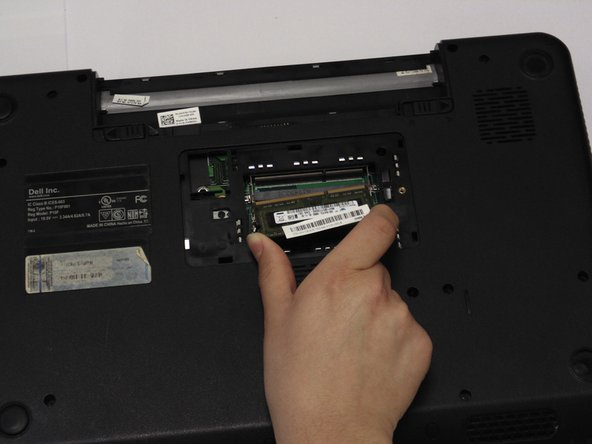 Carefully hold RAM card from the sides and pull away.