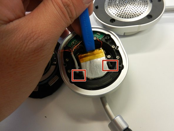 Use an iFixit opening tool or something similar to pry out the battery.