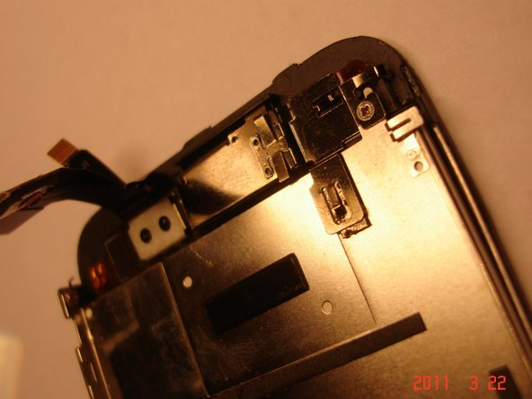 Lift the digitizer and LCD connectors and snap in the bracket/ribbon combo to finish it off.