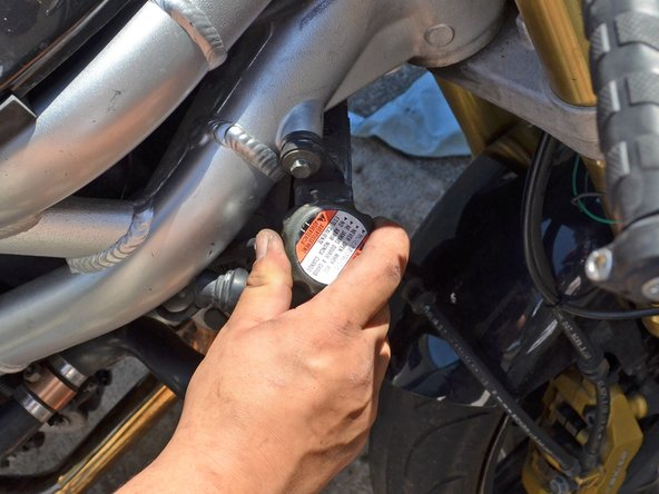 Place the radiator cap back over the filler hole and turn it clockwise until is snug.
