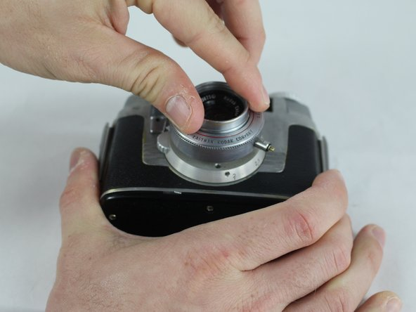 Image 2/2: If the lens assembly has never been removed, it may initially require some force for it to turn.