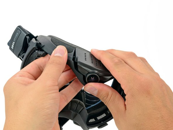 Place one of your hands near the center of the frame with your thumb next to the camera housing.
