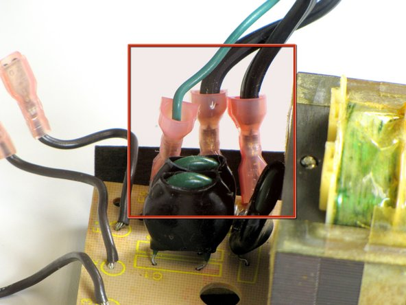 Remove the power cable jumpers from the power supply.