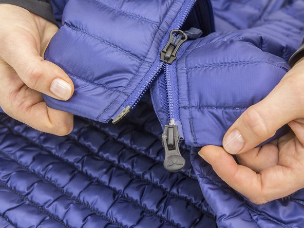 Guide the slider back onto the end of the zip.