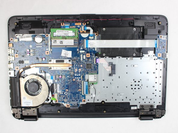 Once you remove the back panel you will see your fan on the bottom left side of your laptop.