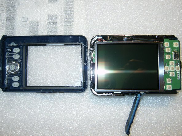 With the back removed, the large LCD becomes immediately visible. There are no fasteners, it just rests inside the tray.