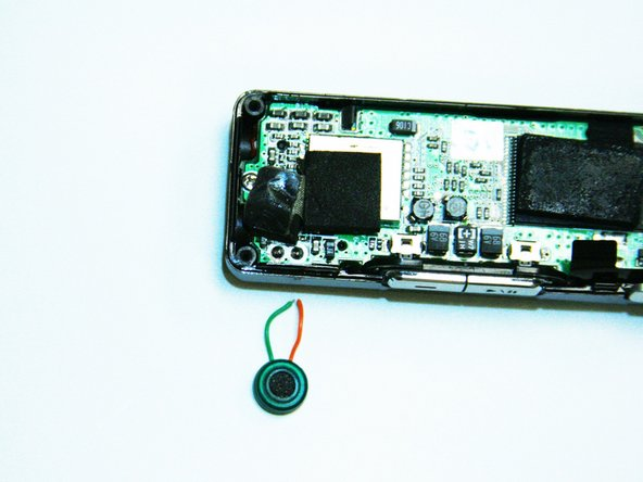 Next, you will need to take the new microphone and solder it to the motherboard using a soldering iron.