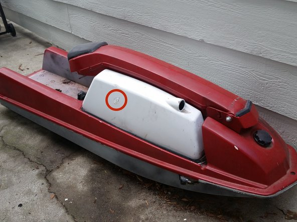 Image 1/3: The hole is highlighted on the jet ski by the red circle.