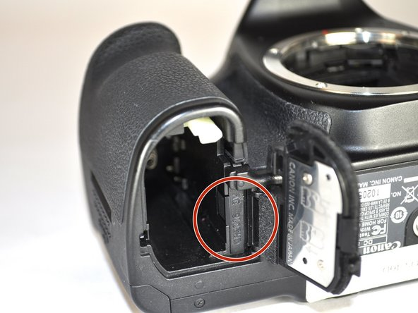 Remove the date and time battery holder by sliding it out of the slot.