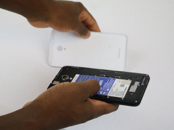 Remove the back cover by sliding your fingernail in the grove around the edge of the phone and prying it off.