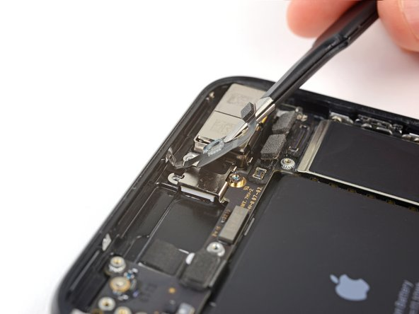 Tilt the antenna flex cable  up toward the top of the iPhone.