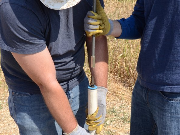 Remove the T-handle, making sure to hold the remaining end of the riser main to prevent dropping it down the well.