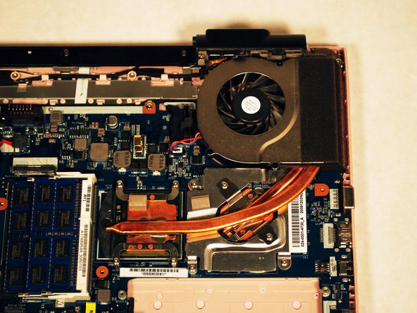 Locate the fan on the top right hand corner of your laptop.