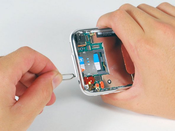 Image 1/1: Press down on the tool until the SIM card tray pops out.