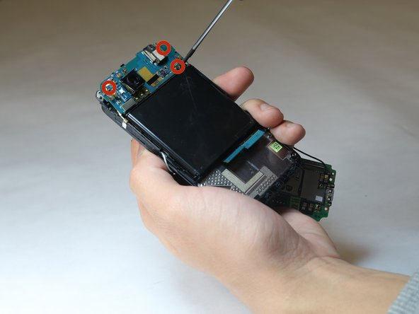 Image 1/3: Use a metal spudger to remove the battery.