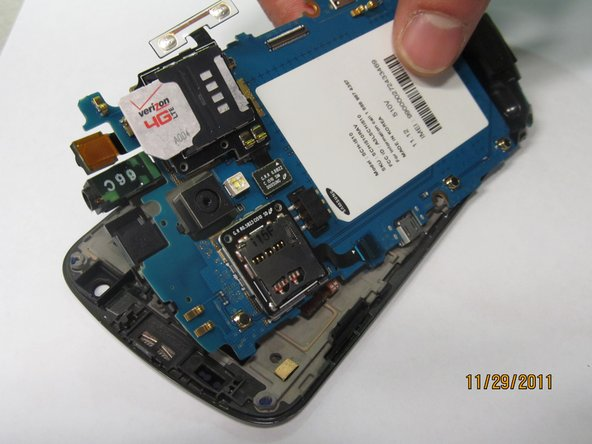 Image 1/1: Release the volume button flex cable on the right.
