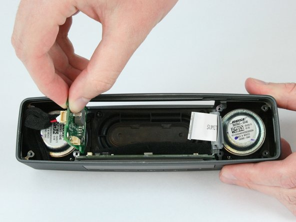 Image 1/2: There is a non latched connector connecting the side board to button board. Be careful to not damage this connector during the removal process.
