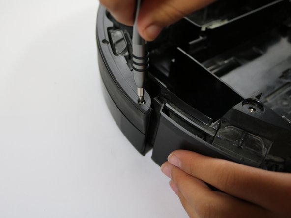 Using a Phillips #1 screwdriver, remove the ten 10mm screws that hold the bumper in place.