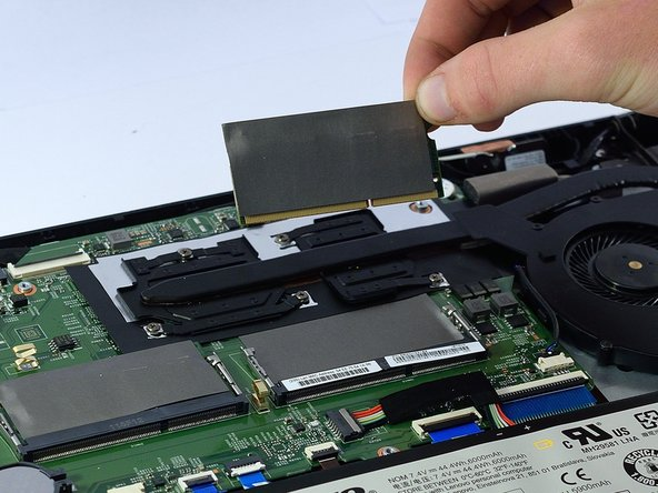 Place new ram unit into the slot and lightly press down to snap it back into place.