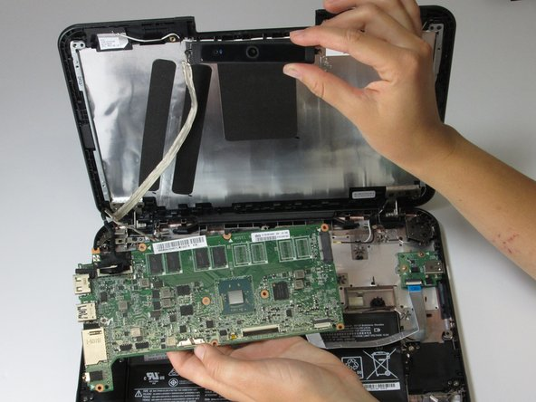 Image 2/2: The motherboard and camera can now be removed from the device.