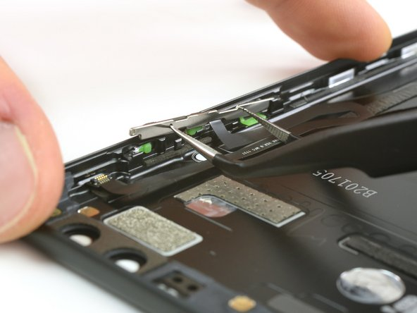 The power and volume button bracket can be removed very easily with a tweezers.