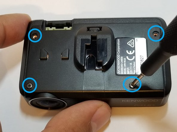 Remove the four 3mm screws from the back of the device using a Phillips #0 screwdriver.