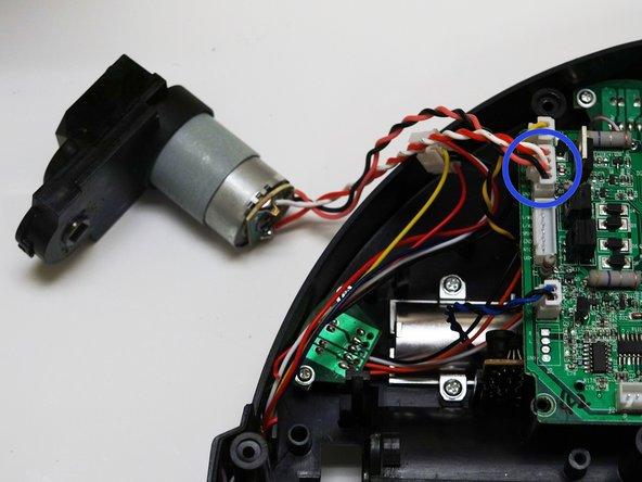 Image 2/3: Slide the motor straight downward until it locks inside bObsweep.