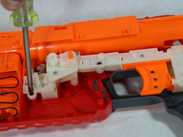 Remove the screws from the trigger mechanism and lift it upward