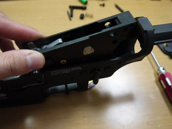 Image 1/3: Insert the receiver pin from the left side with the textured end on top (refer to picture).