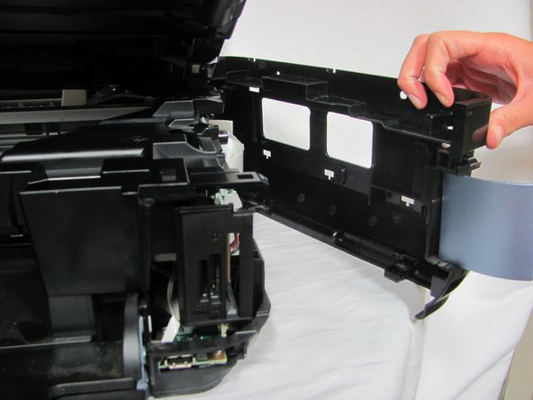 After unclipping all the hooks, pull off the black side panel to reveal the inner circuit boards.