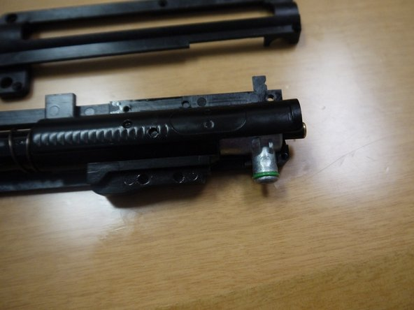 Image 1/3: Tuck the recoil spring in the shell.