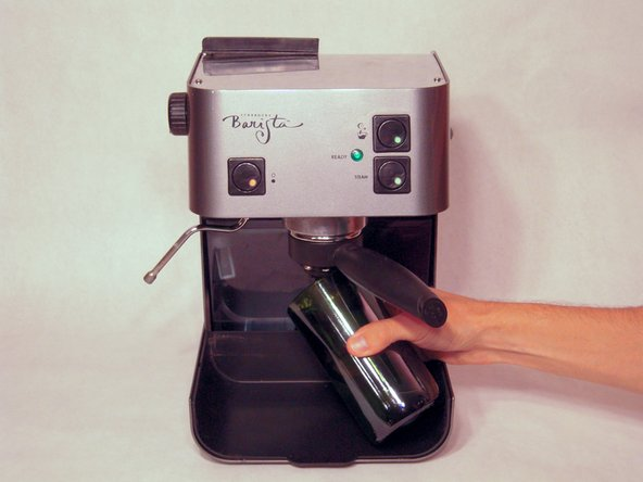 Image 1/1: Place a cup, to catch fluid, underneath the portafilter.