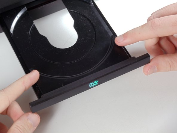 Remove the DVD tray faceplate by pushing the faceplate up off of the tray.